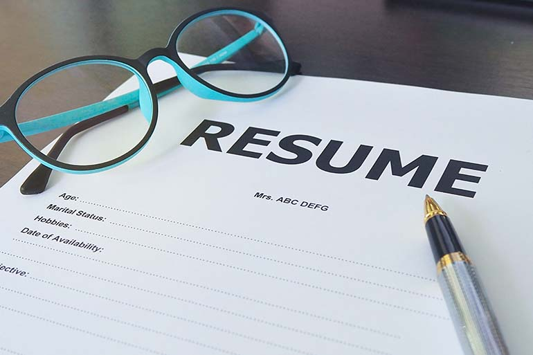 Resume Print Out with pen and glasses