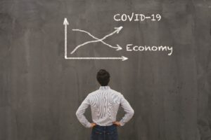 Graph showing COVID-19 cases and the economy shrinking