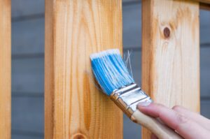 Person varnishing wood
