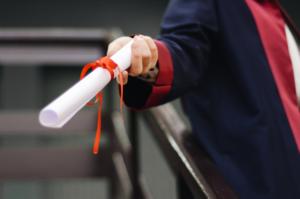 Graduate holding a degree certificate