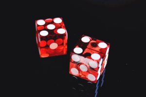 Pair of red dice on a black background