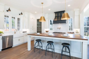 White kitchen units with a wooden floor