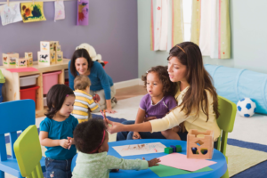 Nursery teacher with group of children