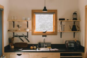 Organised kitchen with shelving and window