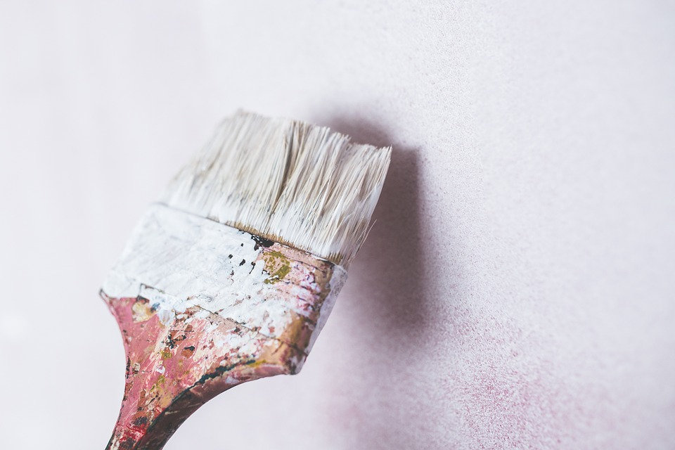 Paint brush covered with white paint