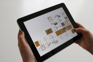 Person Holding Black Ipad