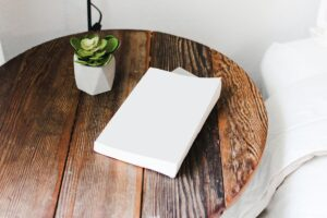 White Book on Brown Round Table
