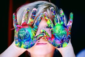 Child with paint on their hands