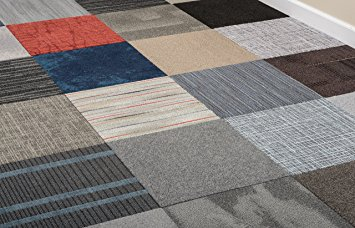Various colours and patterns of carpet tiles laid together