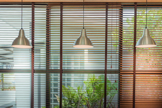 Venetian blinds by the window or blinds window and ceiling lamp beam, blinds window decoration concept.
