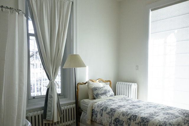 Clean white bedroom with neatly made bed