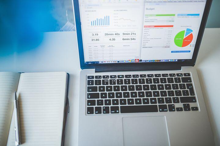 Laptop showing progress graphs on screen