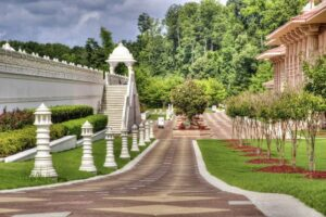 Ornamental garden with a tree-lined road