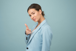 Confident looking women pointing at camera
