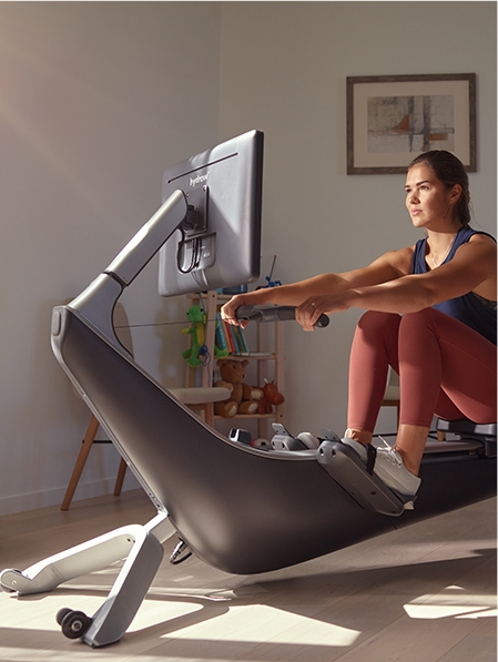 Hydrow Athlete Sera Moon using Hydrow Rower in an apartment