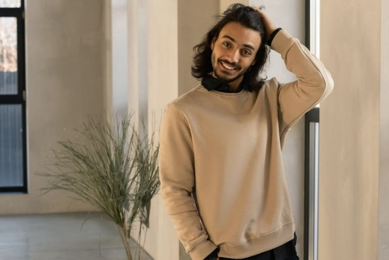 Smiling man wearing a baggy jumper