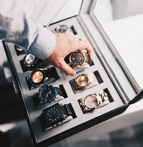 Collection of watches in a storage box