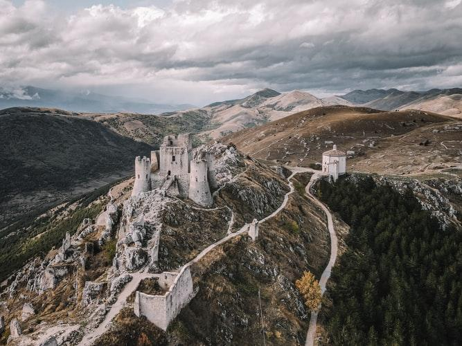 Ariel view of a castle on top of a hill