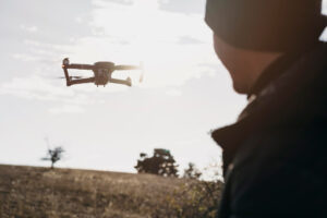 Closeup of person watching a drone fly