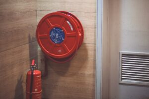 Fire hose and fire extinguisher on a wall