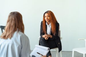 Woman in a suit being interviewed